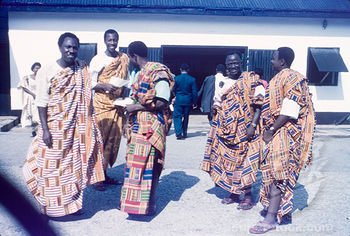 Ghanaian men wearing kente cloth.